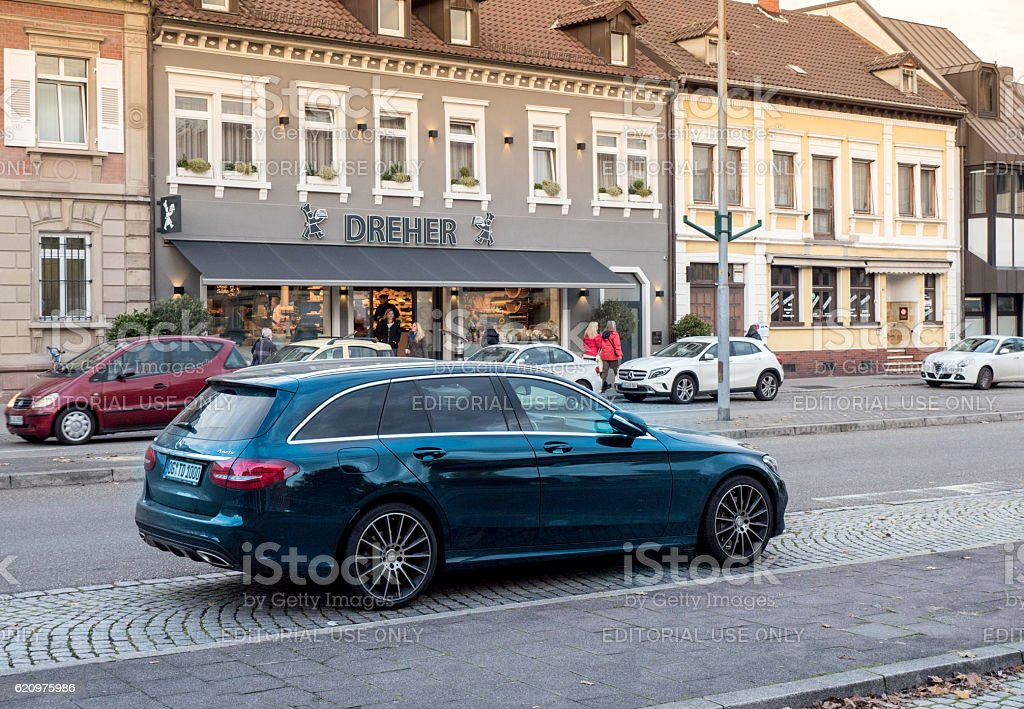 Mercedes-Benz estate wagon car parked in center of typical Germa stock photo