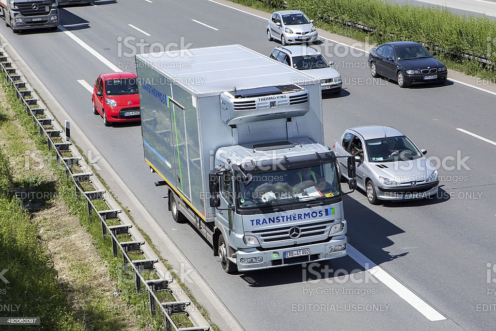 Mercedes-Benz refrigerated transport truck on German highway stock photo