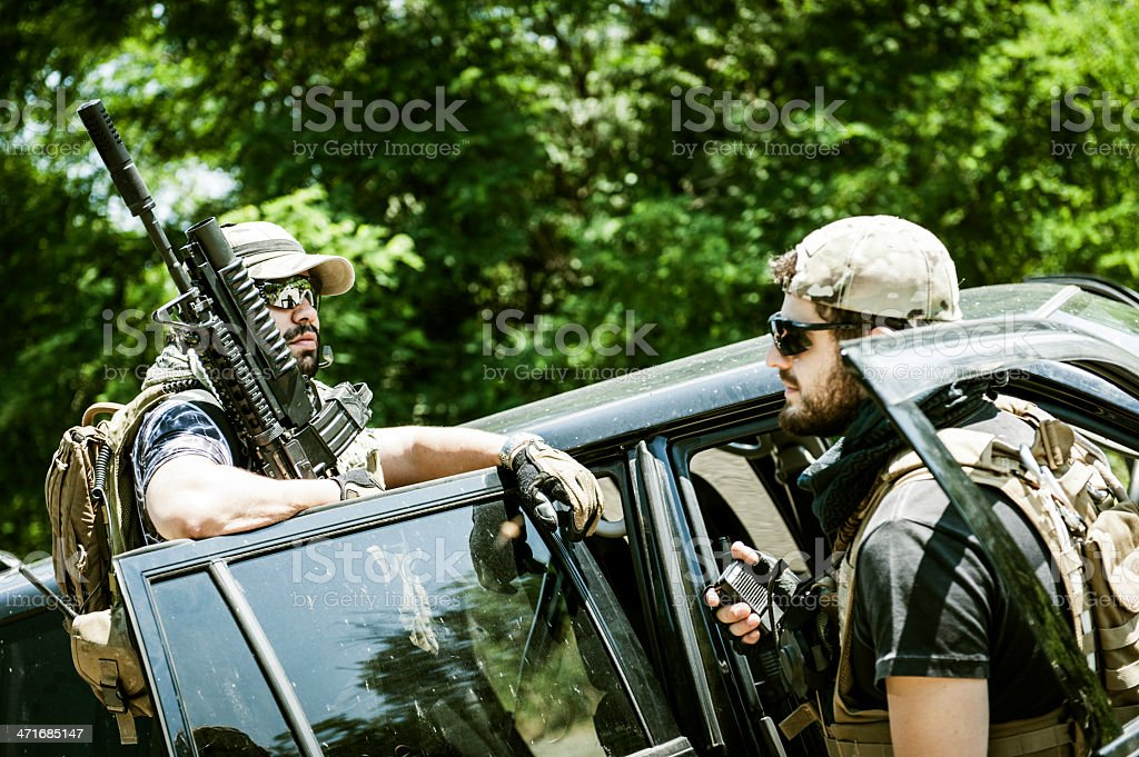 Mercenary Contractor Soldiers Guarding a Roadblock Checkpoint stock photo