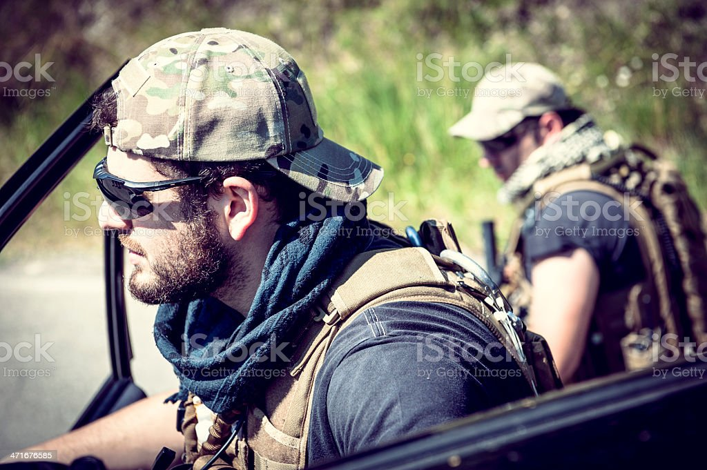 Mercenary Contractor Soldiers Guarding a Roadblock royalty-free stock photo