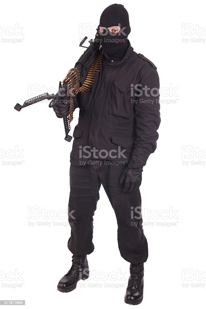 mercenary in black uniforms with machine gun stock photo