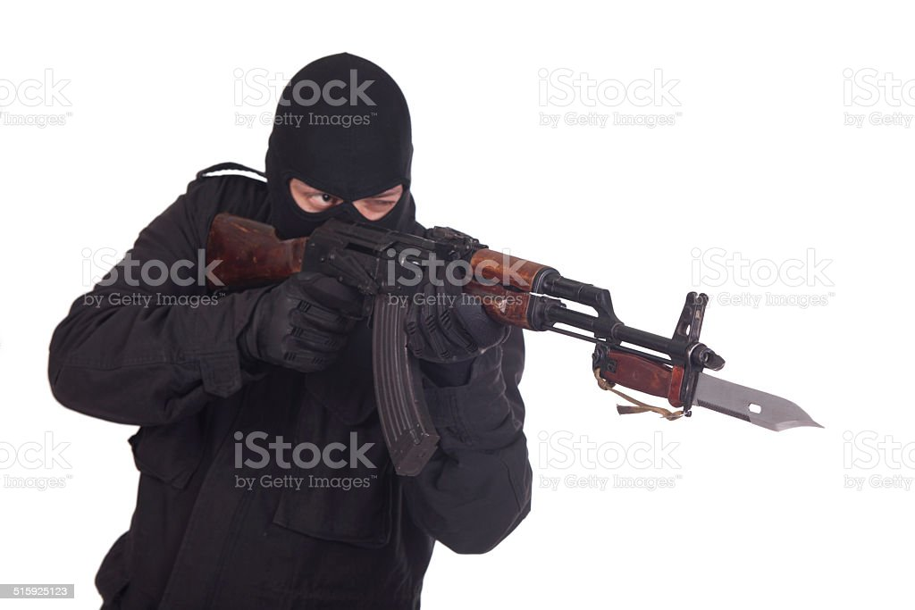mercenary with AK 47 gun witn bayonet stock photo