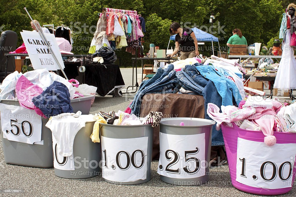Merchandise Labeled With Prices On Display At Garage Sale stock photo
