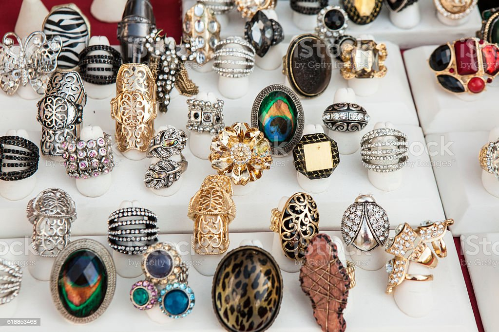 Merchandising: Display of assorted costume jewelry rings for sale stock photo