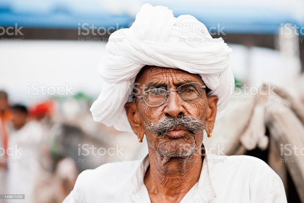 Indian Merchant with white turban at the Pushkar Camel Fair, Pushkar,...