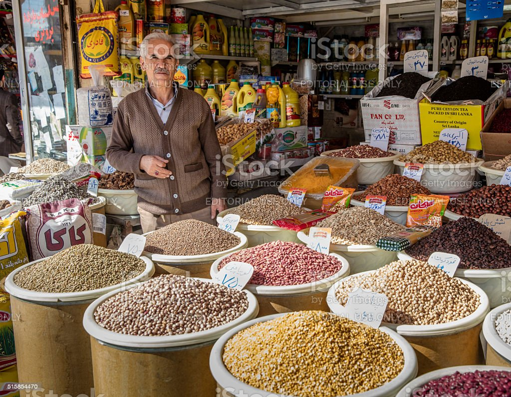 Merchant standing in his streetside shop, Kermanshah, Iran stock photo