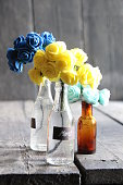 Merci tag and nice flowers in the bottles on wooden