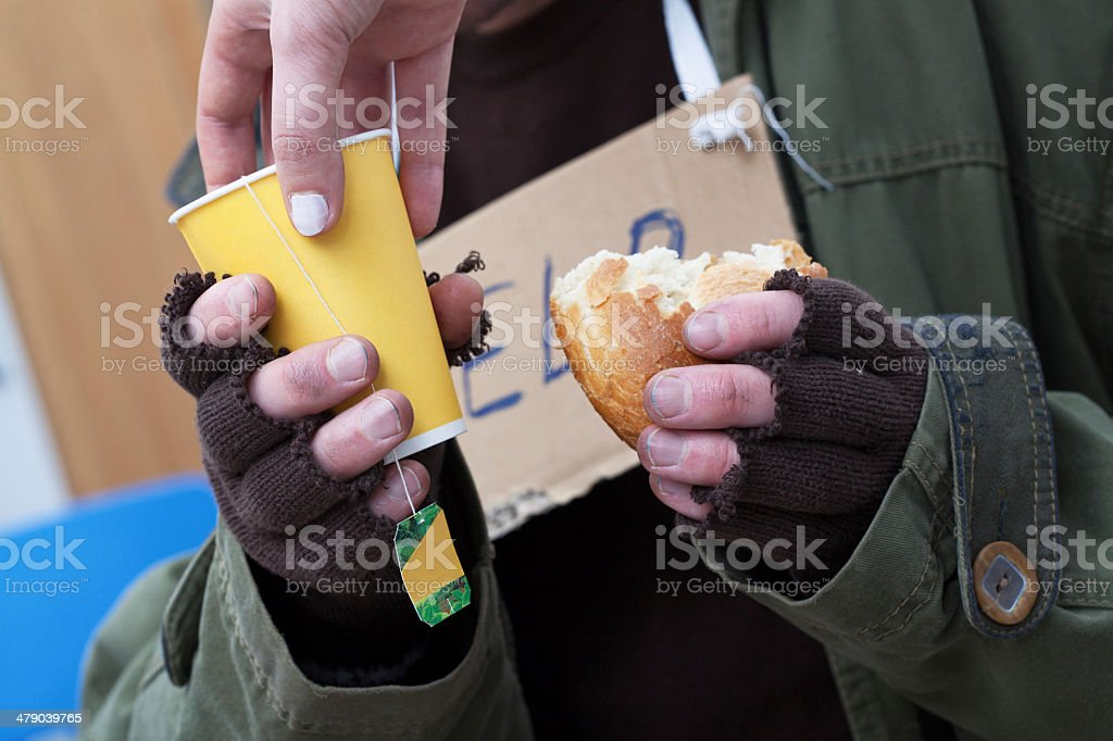 Mercy for poor homeless man stock photo
