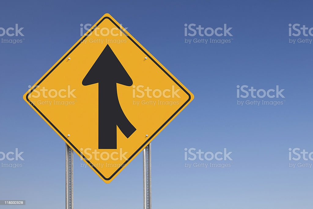 Merge Ahead Traffic Sign Post over Clear Blue Sky Background stock photo