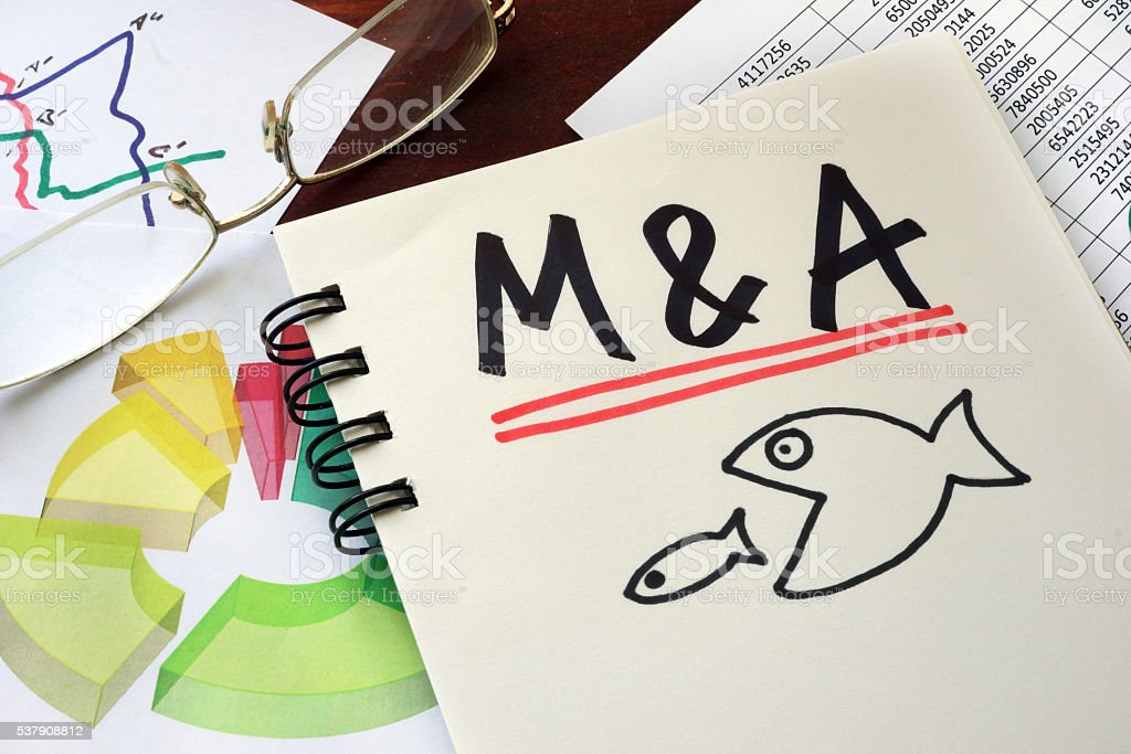 M&A Merger And Acquisitions written on a notepad. stock photo