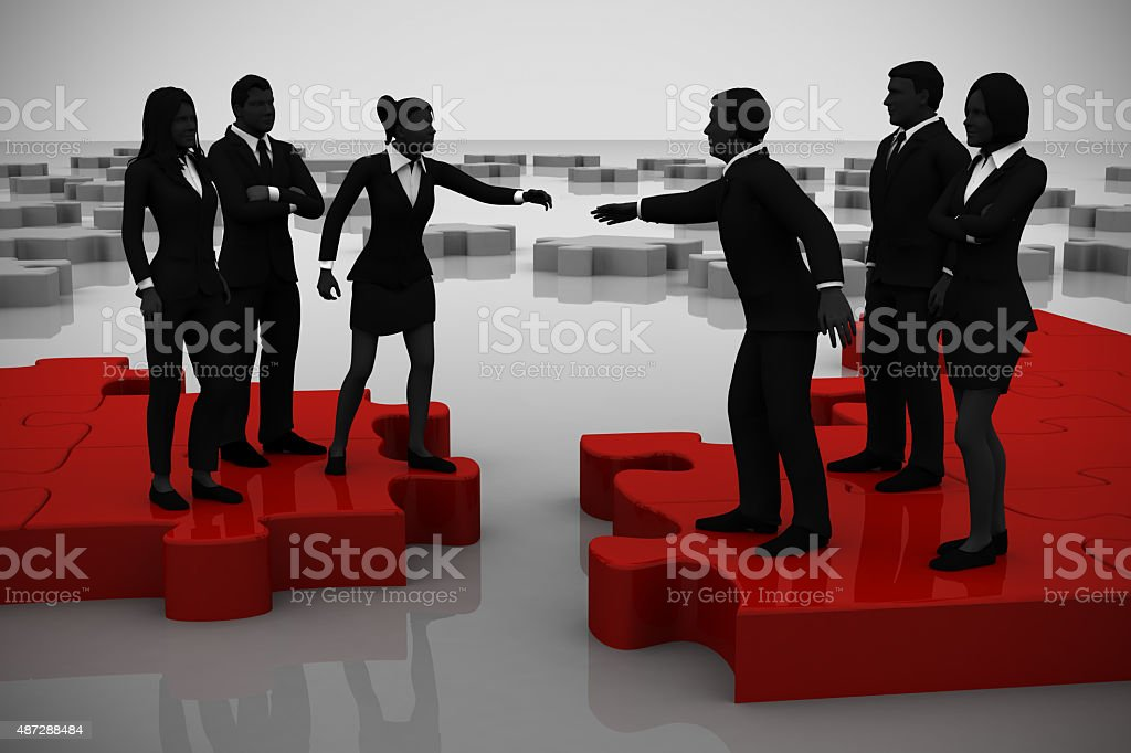 Merger of two teams on a jigsaw puzzle. stock photo