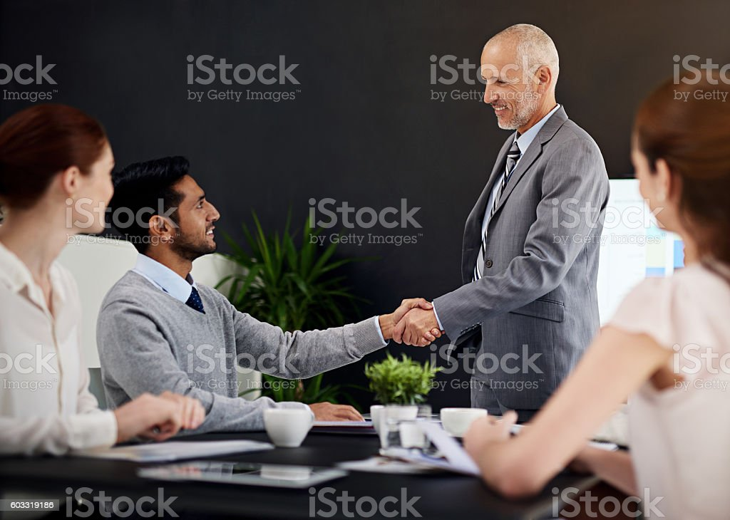 Merging their talents for the ultimate success stock photo