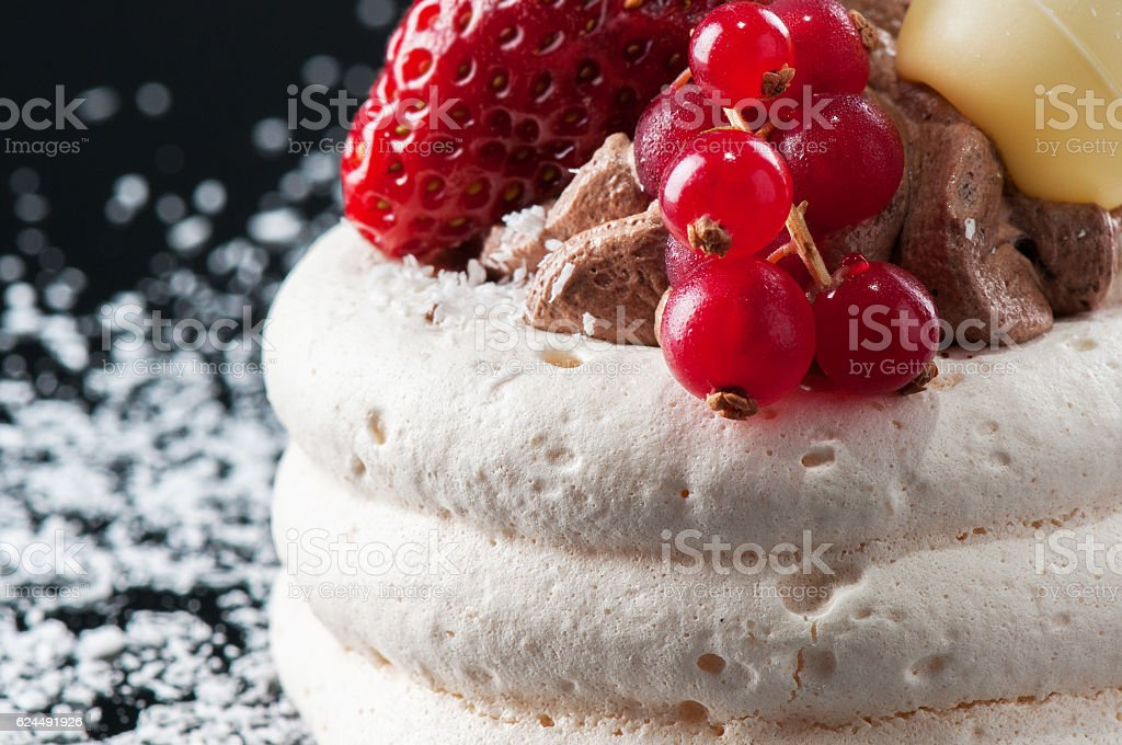 Meringue cake with strawberry and currants stock photo