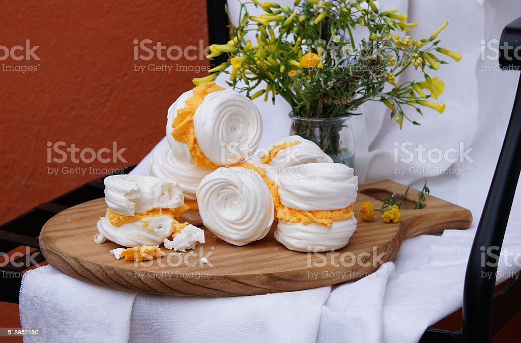 meringue cookies with butter cream stock photo