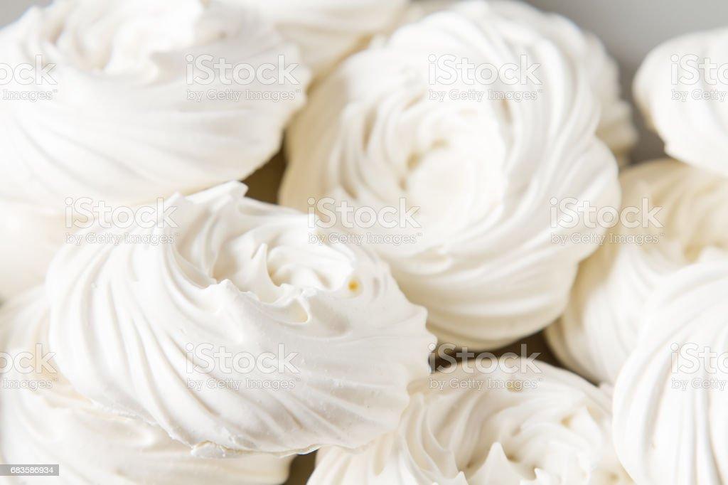 Meringue dessert Pavlova cake with fresh berries on a stone background stock photo