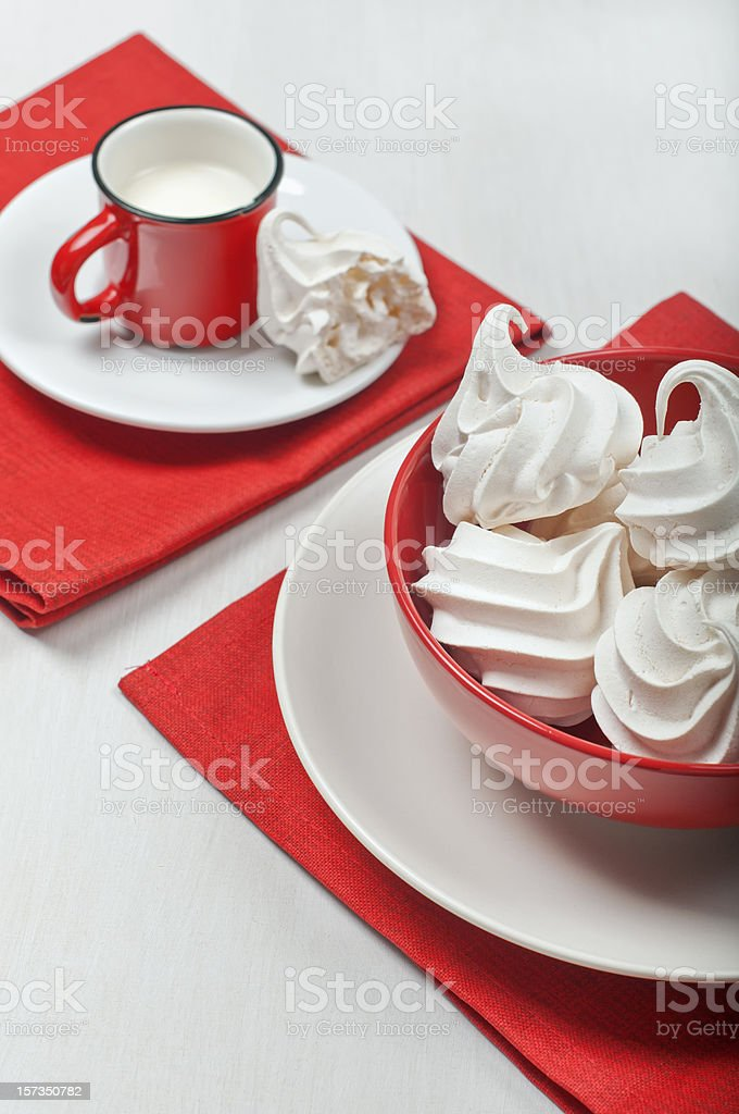 Meringue in a red bowl royalty-free stock photo