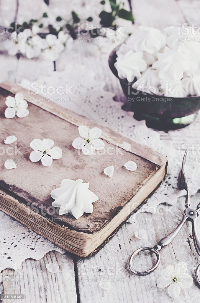 Meringue kisses and cherry flowers, vintage decoration stock photo