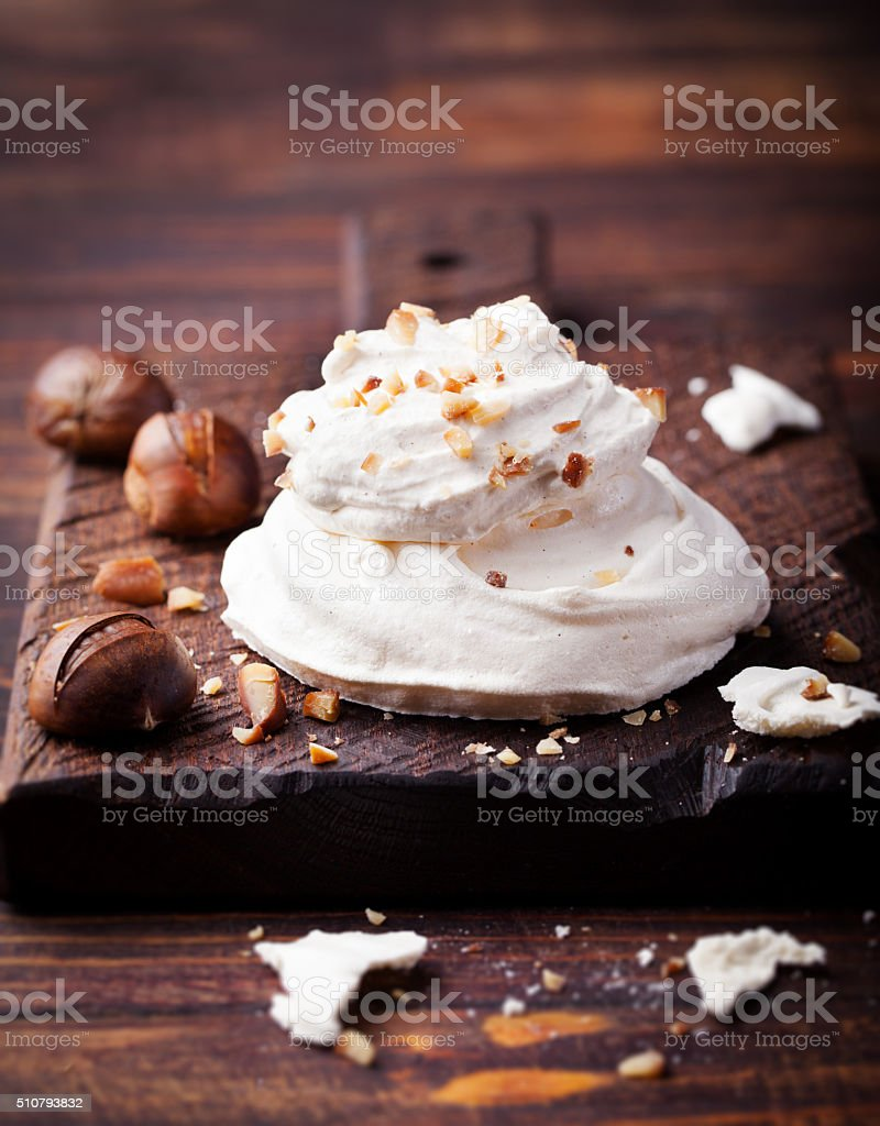 Meringue pavlova cake with chestnut cream Wooden background stock photo