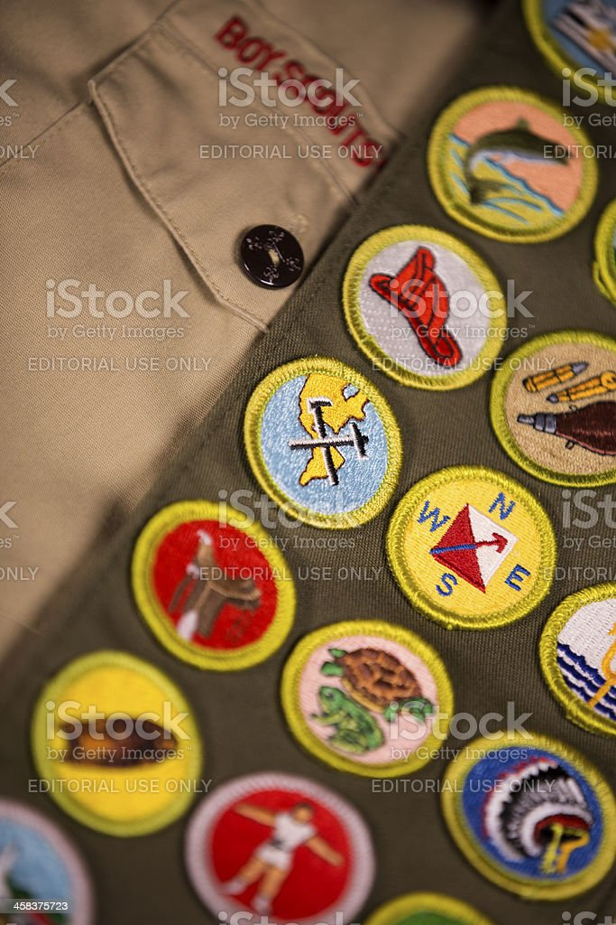 Merit badges and shirt of scout uniform stock photo