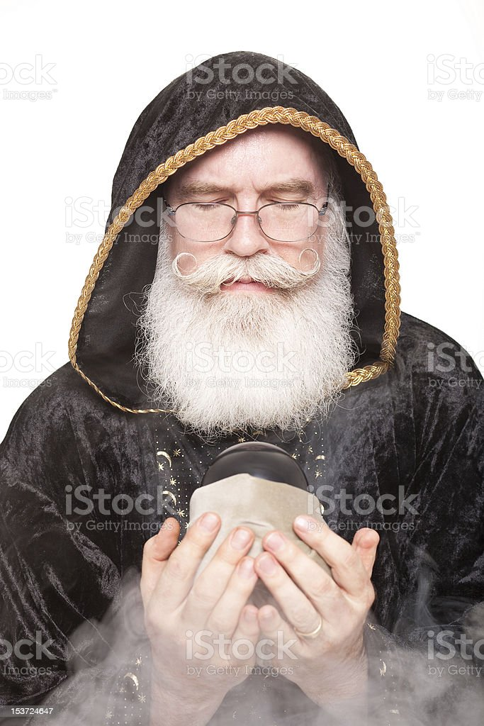 Merlin looks into his magic orb stock photo