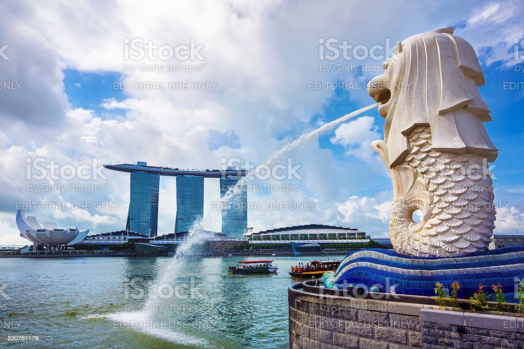 Merlion Statue and Marina Bay Sands Hotel in Singapore stock photo
