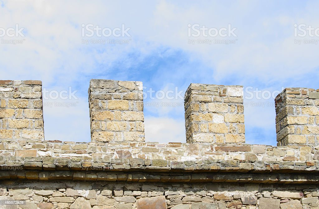 Merlons of ancient stone wall closeup stock photo