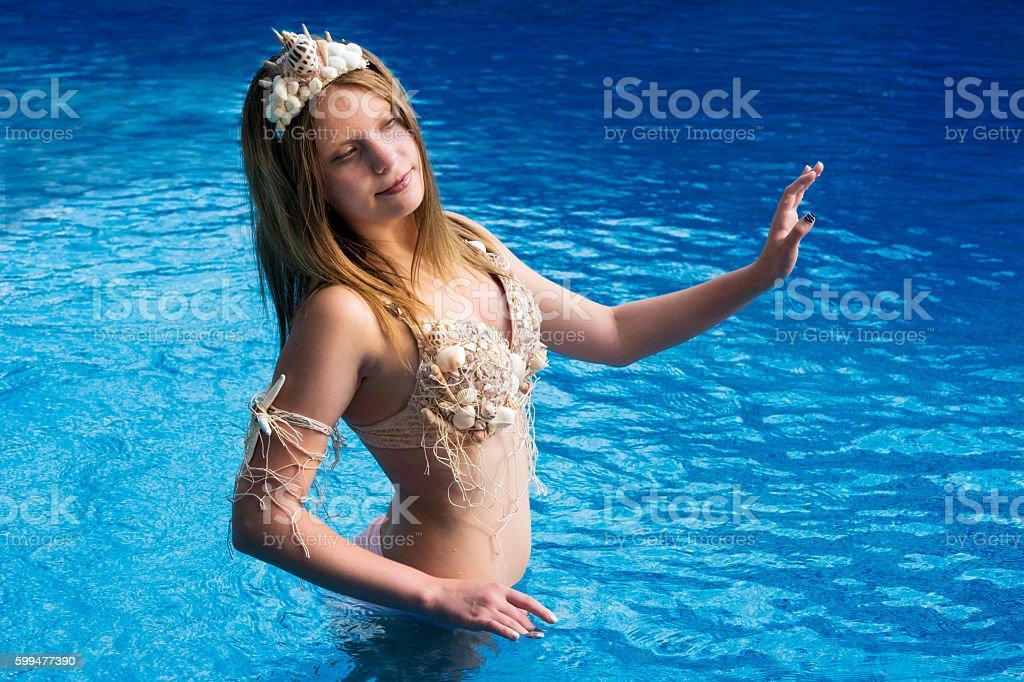 Mermaid girl in feminine pose stock photo