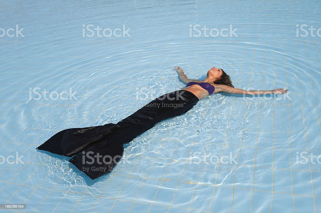 Mermaid in shallow water stock photo