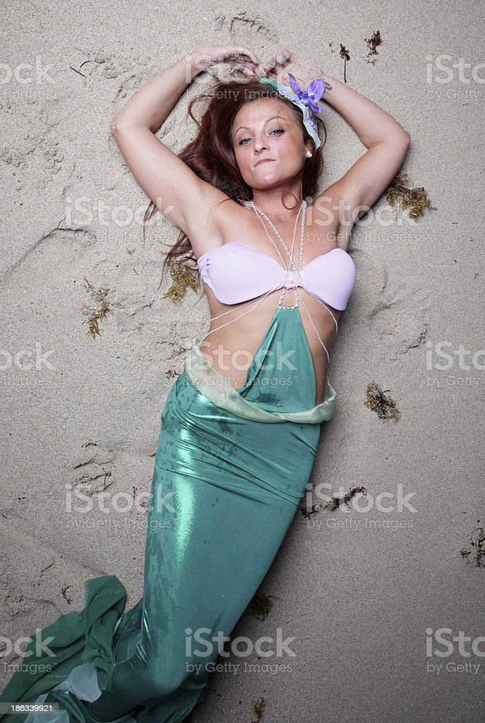 Mermaid on the sand royalty-free stock photo