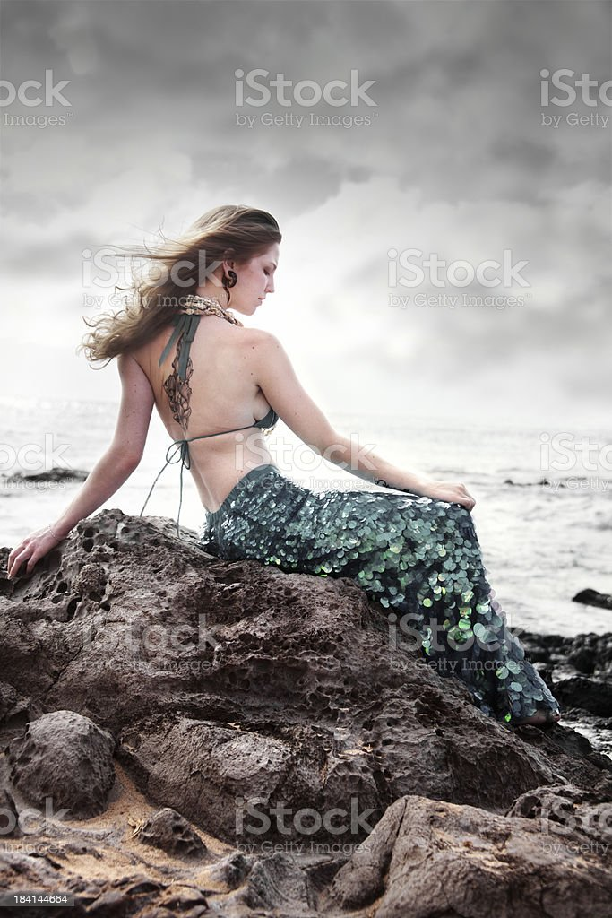 Mermaid sitting on a rock royalty-free stock photo
