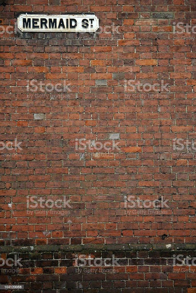 mermaid street brick wall background rye royalty-free stock photo