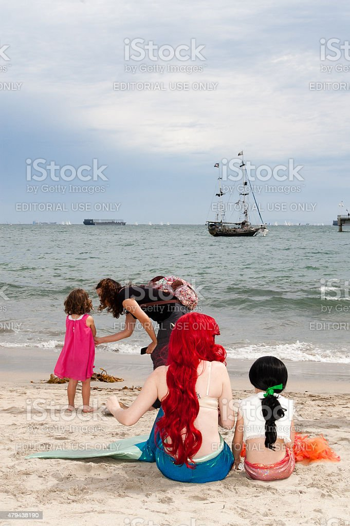 Mermaids on the beach at the Pirate Invasion festival stock photo