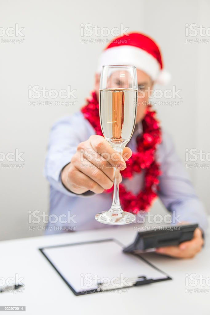 Merry Christmas and Happy Holidays! Handsome man with Santa symbol stock photo