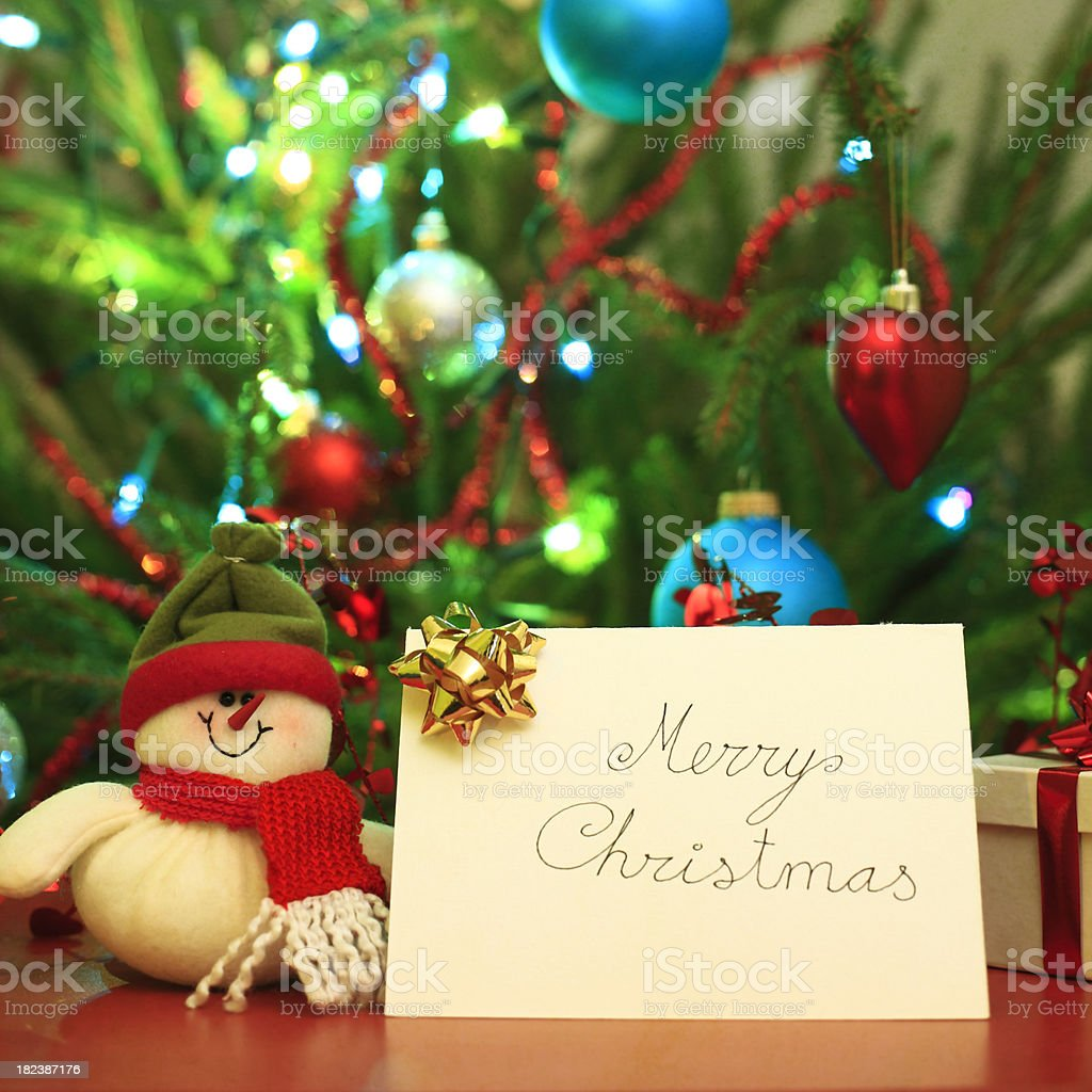 Merry Christmas card and snowman royalty-free stock photo