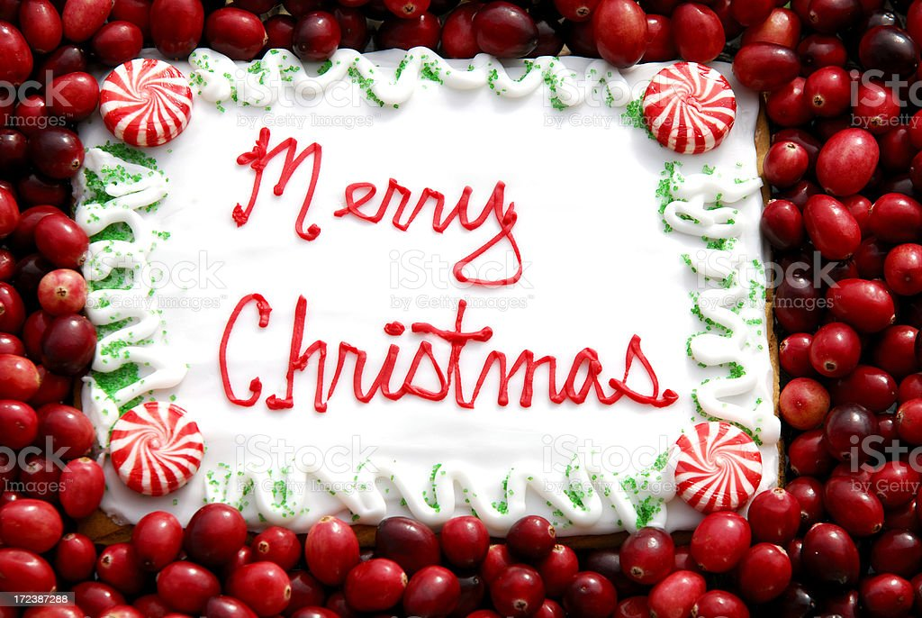 Merry Christmas Cookie Greeting with Cranberries royalty-free stock photo