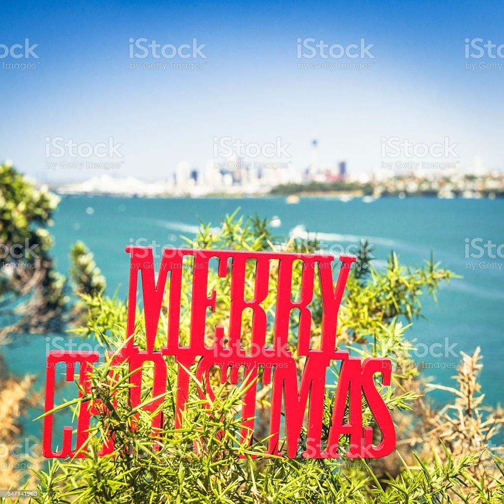 Merry Christmas decoration seen against Auckland  skyline stock photo