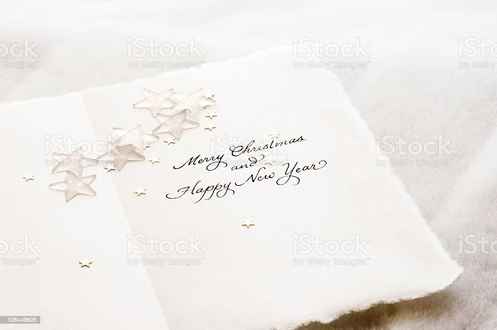 Merry Christmas Happy New Year Calligraphy, white stars, japanese paper stock photo