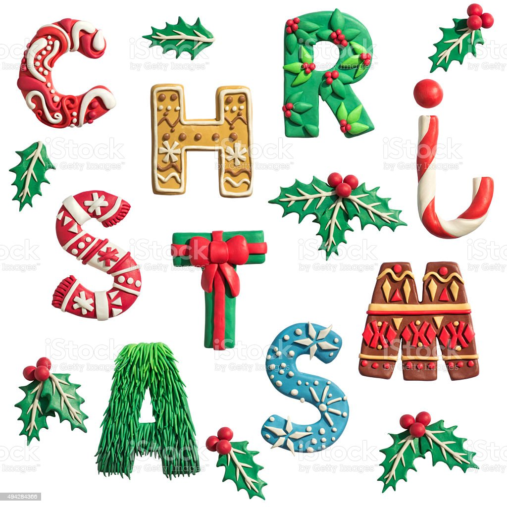 Merry Christmas holiday letters handmade of plasticine with holly. stock photo