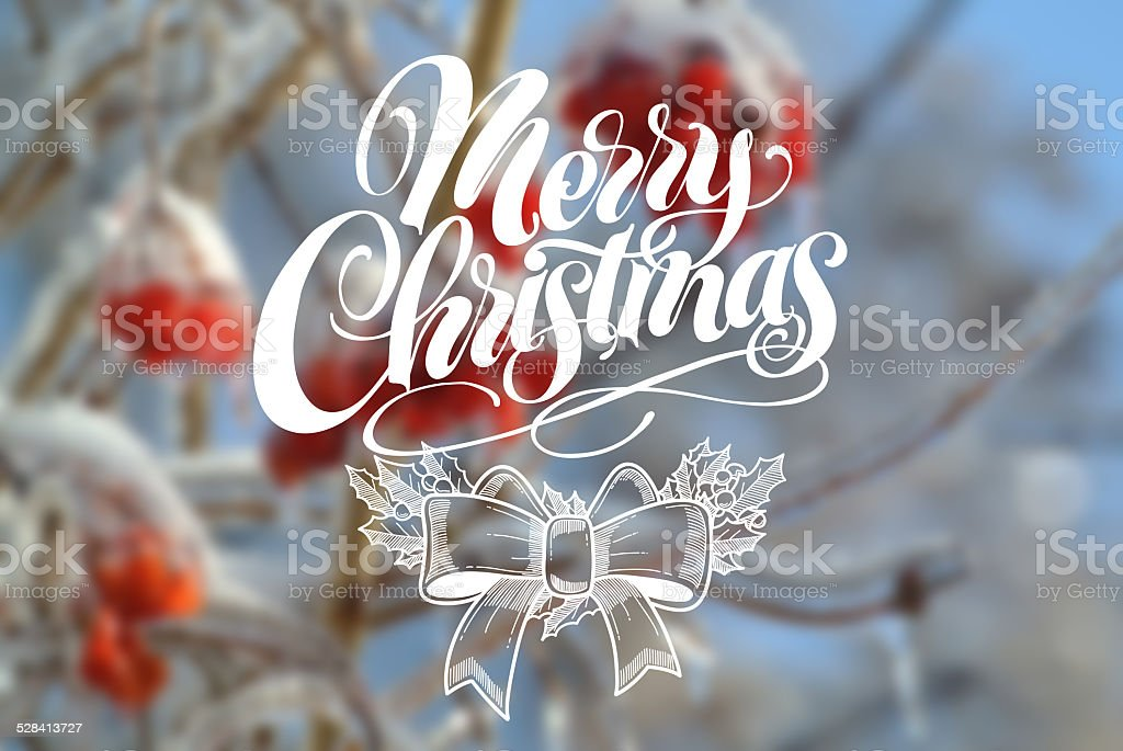 Merry Christmas on blur winter photo background. stock photo