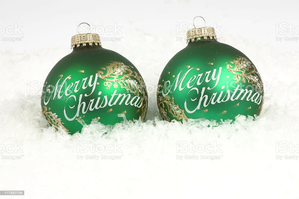 Merry Christmas Ornaments on Artificial Snow Background stock photo