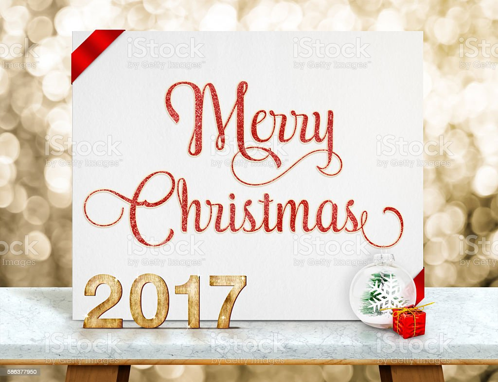 Merry Christmas red glitter on white paper card with 2017 stock photo