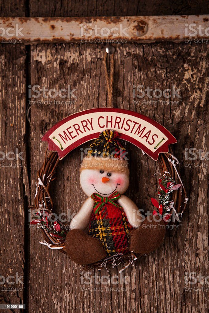 Merry Christmas sign on distressed wooden background stock photo