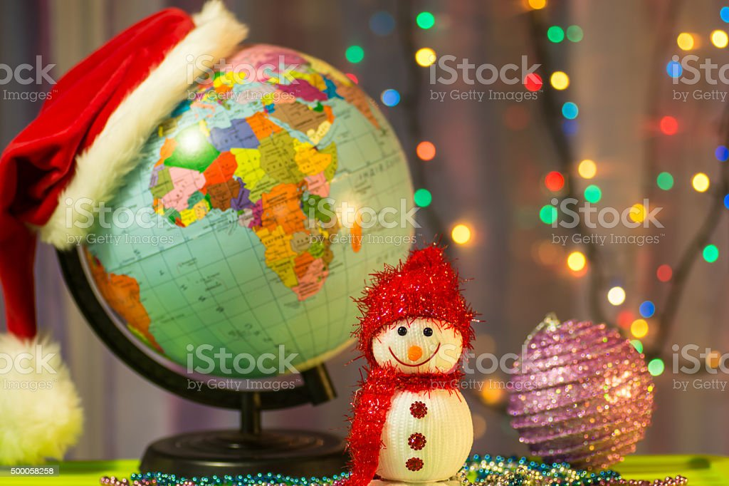 Merry Christmas Snowman on the background of globe stock photo