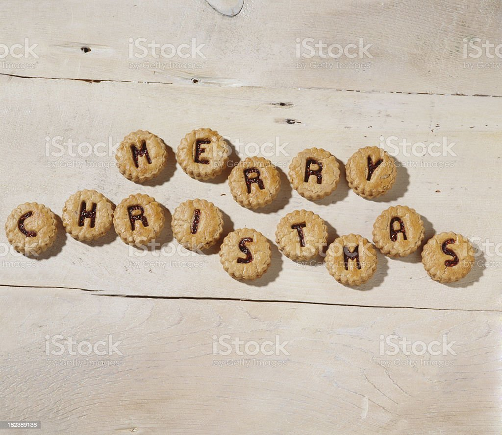Merry Christmas spelled with jam filled shortbread royalty-free stock photo