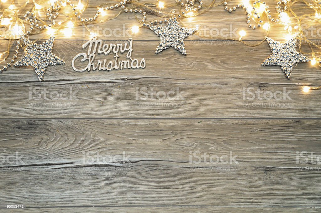 Merry Christmas text on the wooden background stock photo