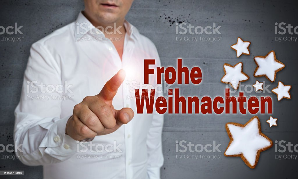 Frohe Weihnachten (in german merry christmas) touchscreen is ope stock photo