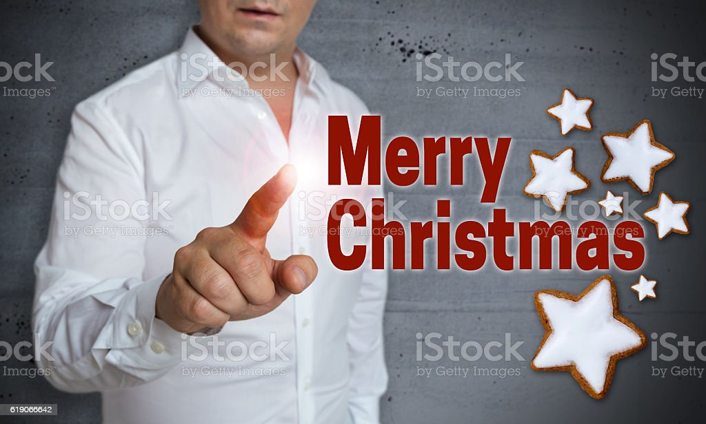 Merry christmas touchscreen is operated by man stock photo