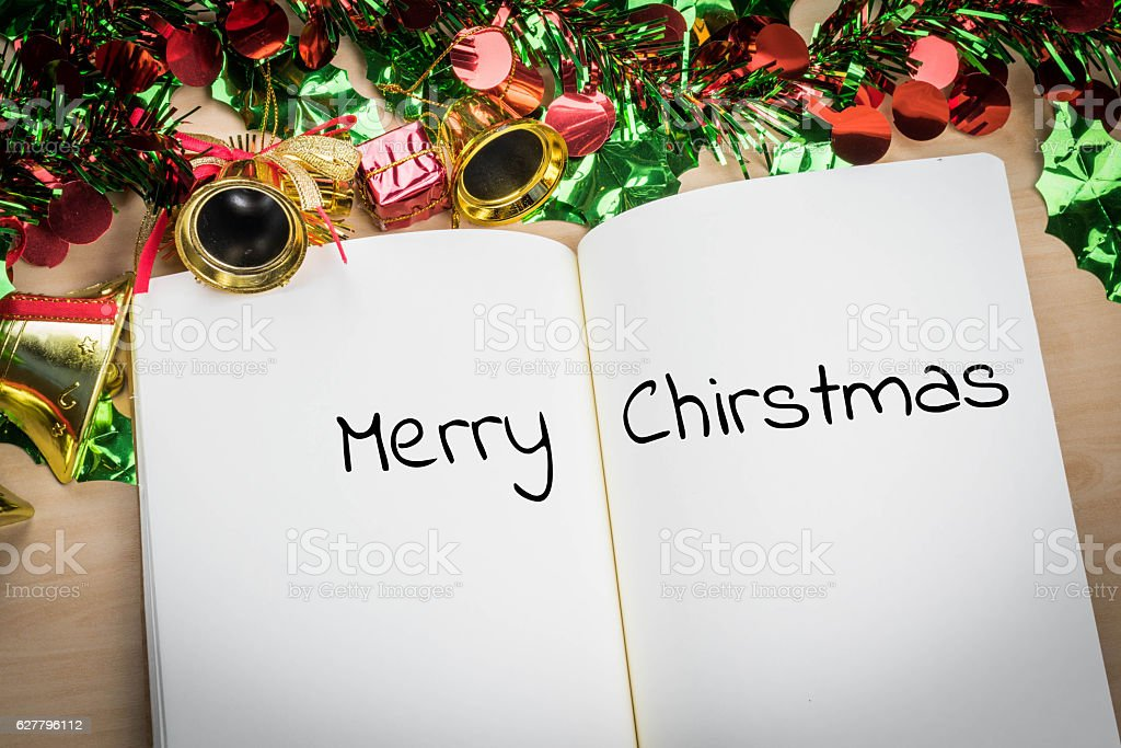 merry christmas word in note book with christmas decoration stock photo