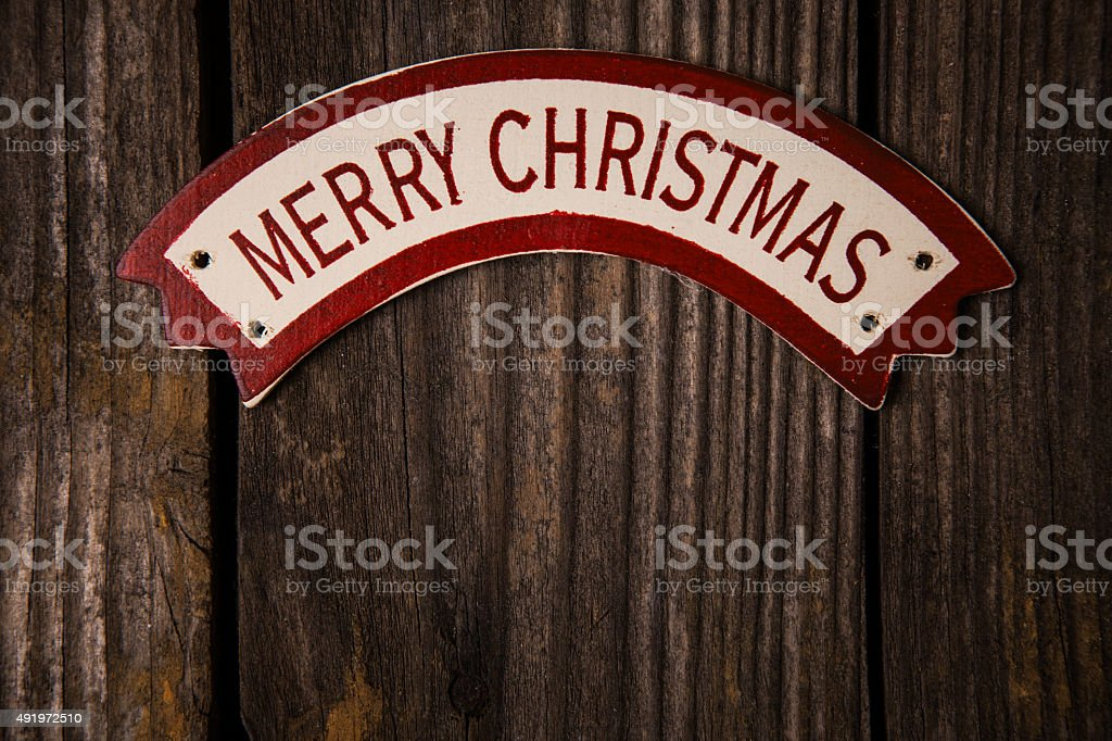 Merry Christmas words on banner over old wood surface stock photo