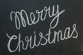 Merry Christmas written on a blackboard with chalk